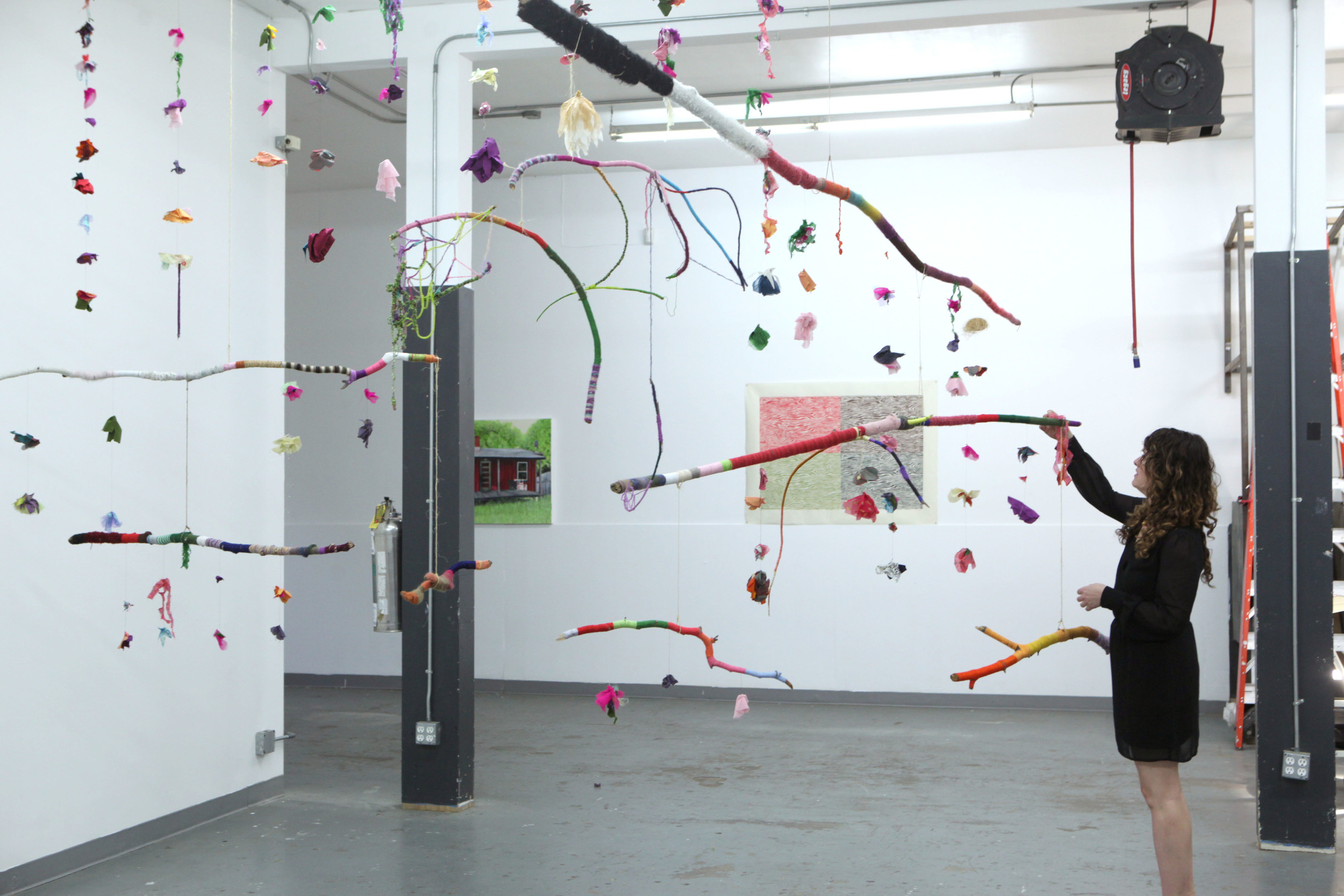 """Jessica Amos """"Hanging Garden/Resurrection Toy"""" : branches, embriodery floss, fabric, twine, and thread"""