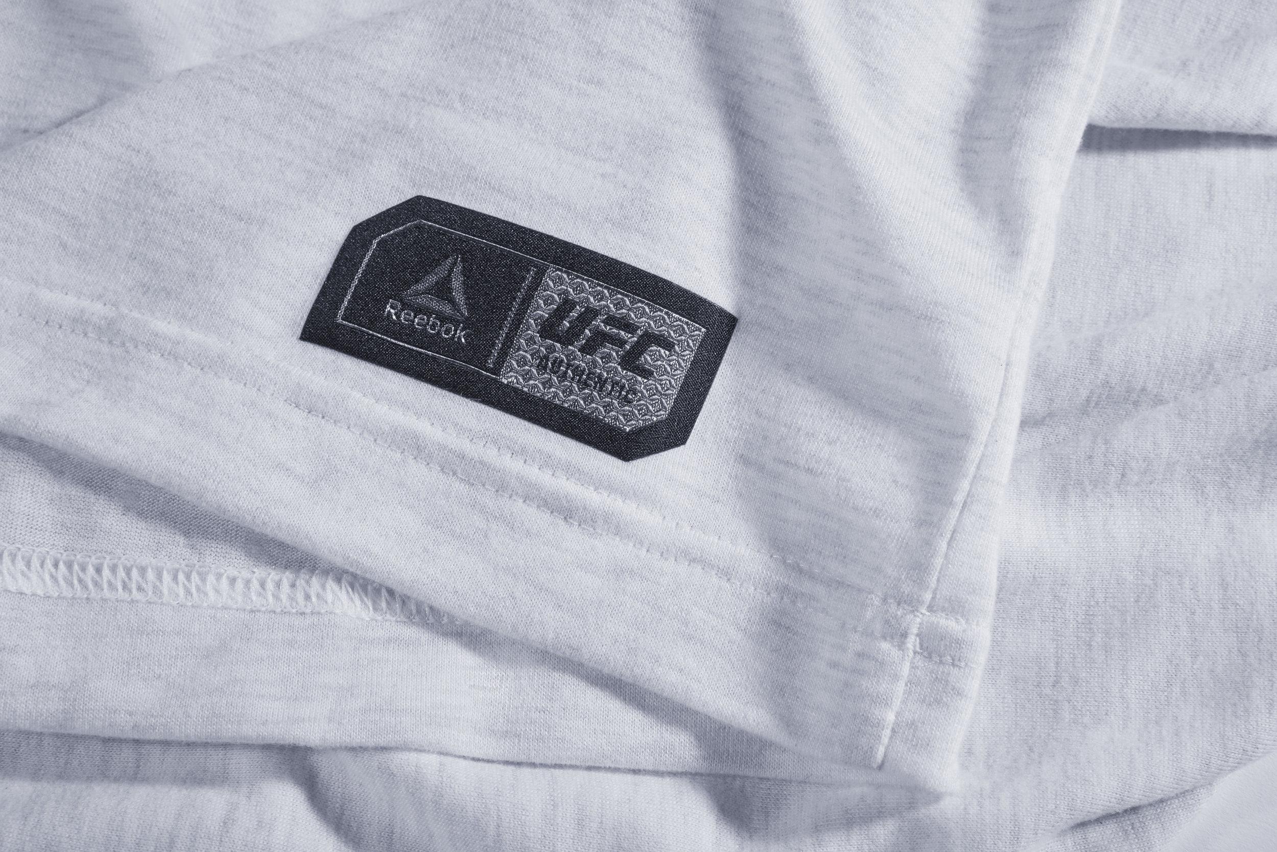 C21101_FW17_UFC_FNC_Tee_White_Label_Detail.jpg
