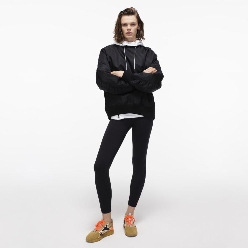 Victoria_Beckham_Packable_Jacket_White_FI9370_22_model.jpg