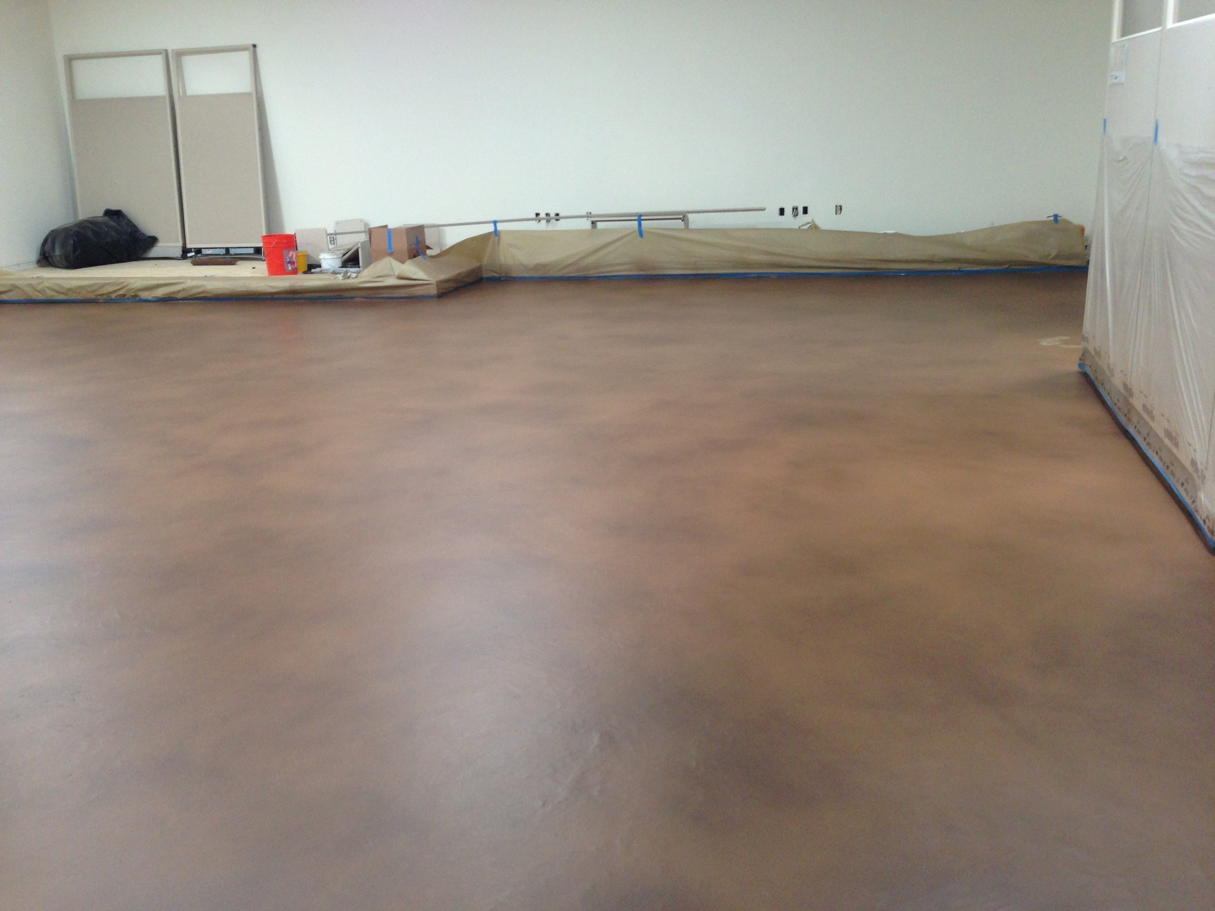 After: Self leveling and Concrete overlay installed with matte finish.