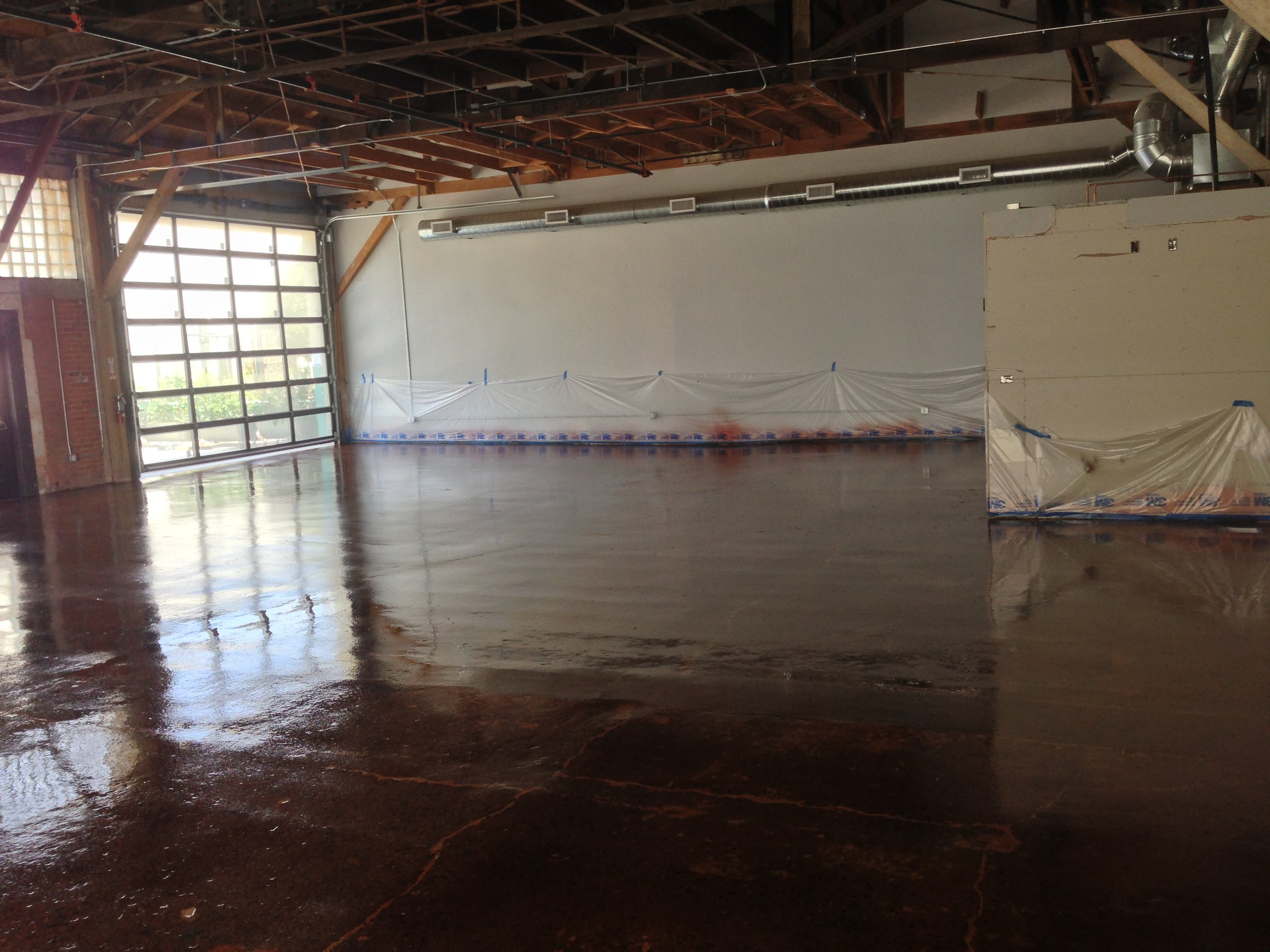 After: Heavy grinding and filling completed, floor was then stained and sealed with industrial strength 100% solids epoxy and top-coated with polyurea.