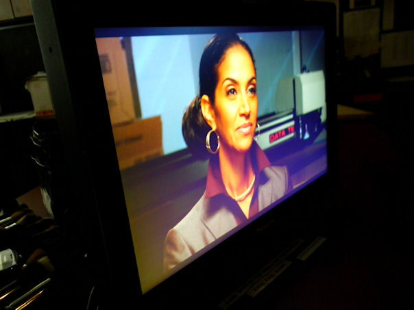 "On location with Black Enterprise ""Black Business Report"" TV show. Camera check for TV show host Caroline Clarke."
