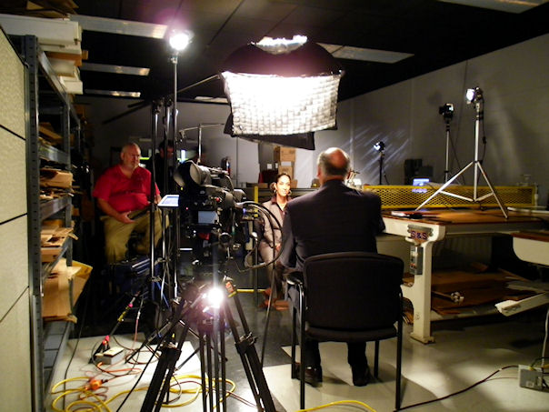 """On location with lack Enterprise """"Black Business Report"""" TV show. Caroline Clarke interviewing Edgar Smith, CEO of World Pac Paper."""