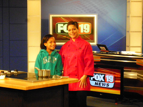 Taren Kinebrew of  Sweet Petite Desserts  with her daughter on the FOX19 set