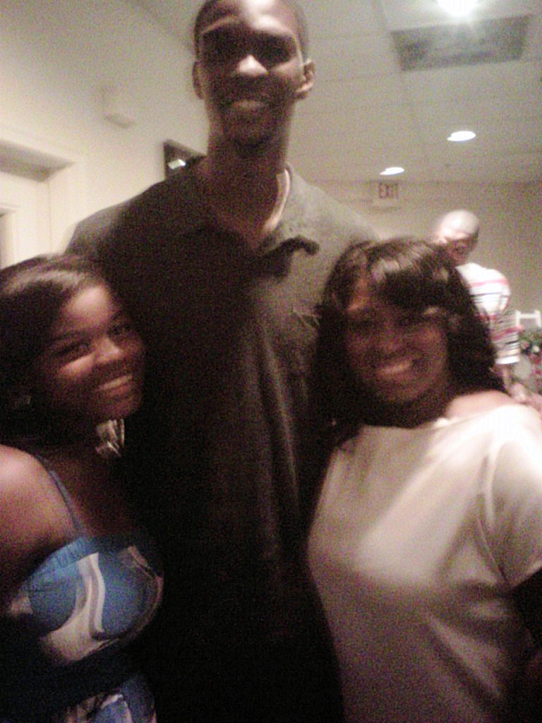 It's a family reunion!  Me with my daughter and cousin Chris Bosh of Miami Heat.
