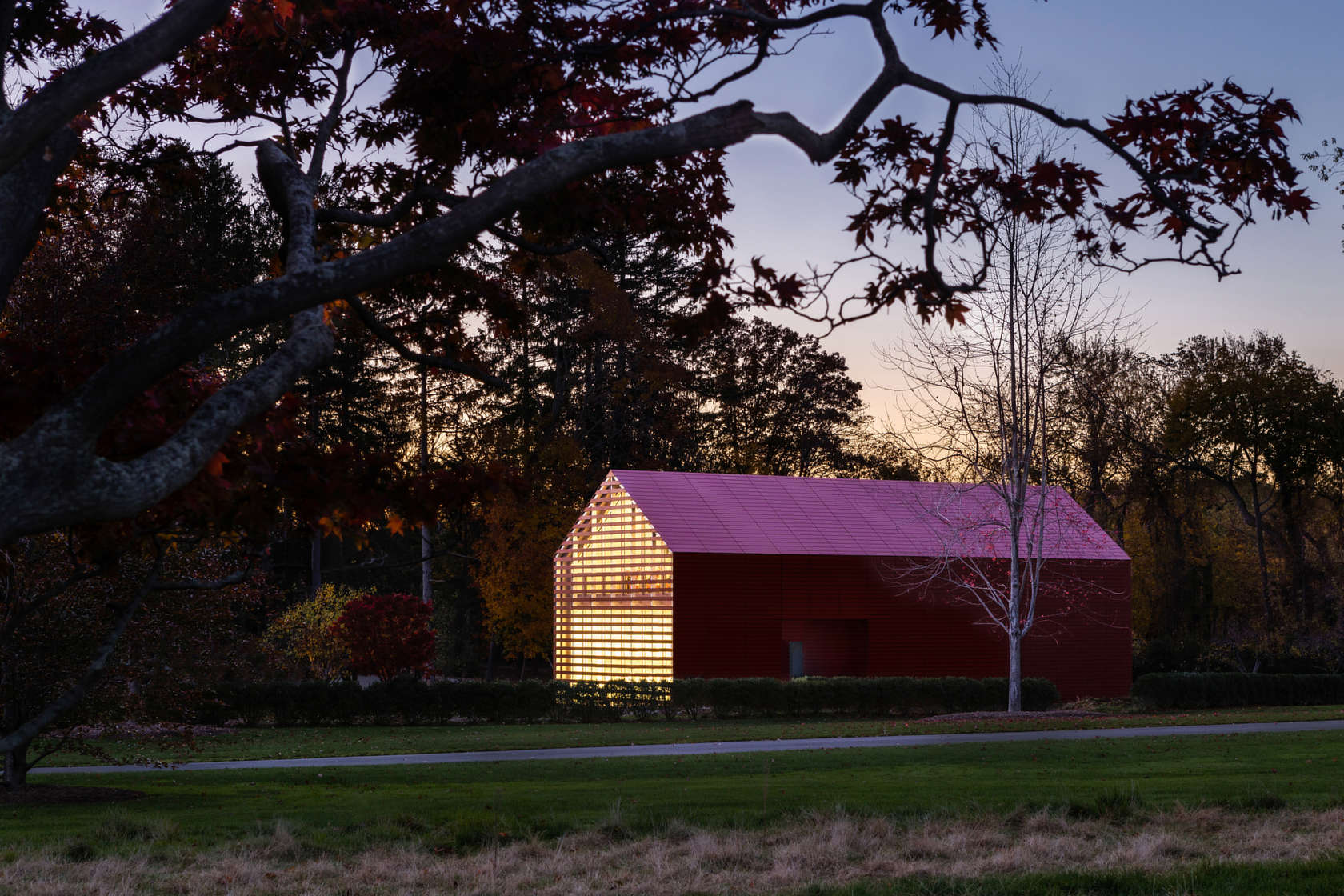 Overall dusk view of Red Barn designed by Roger Ferris + Partners