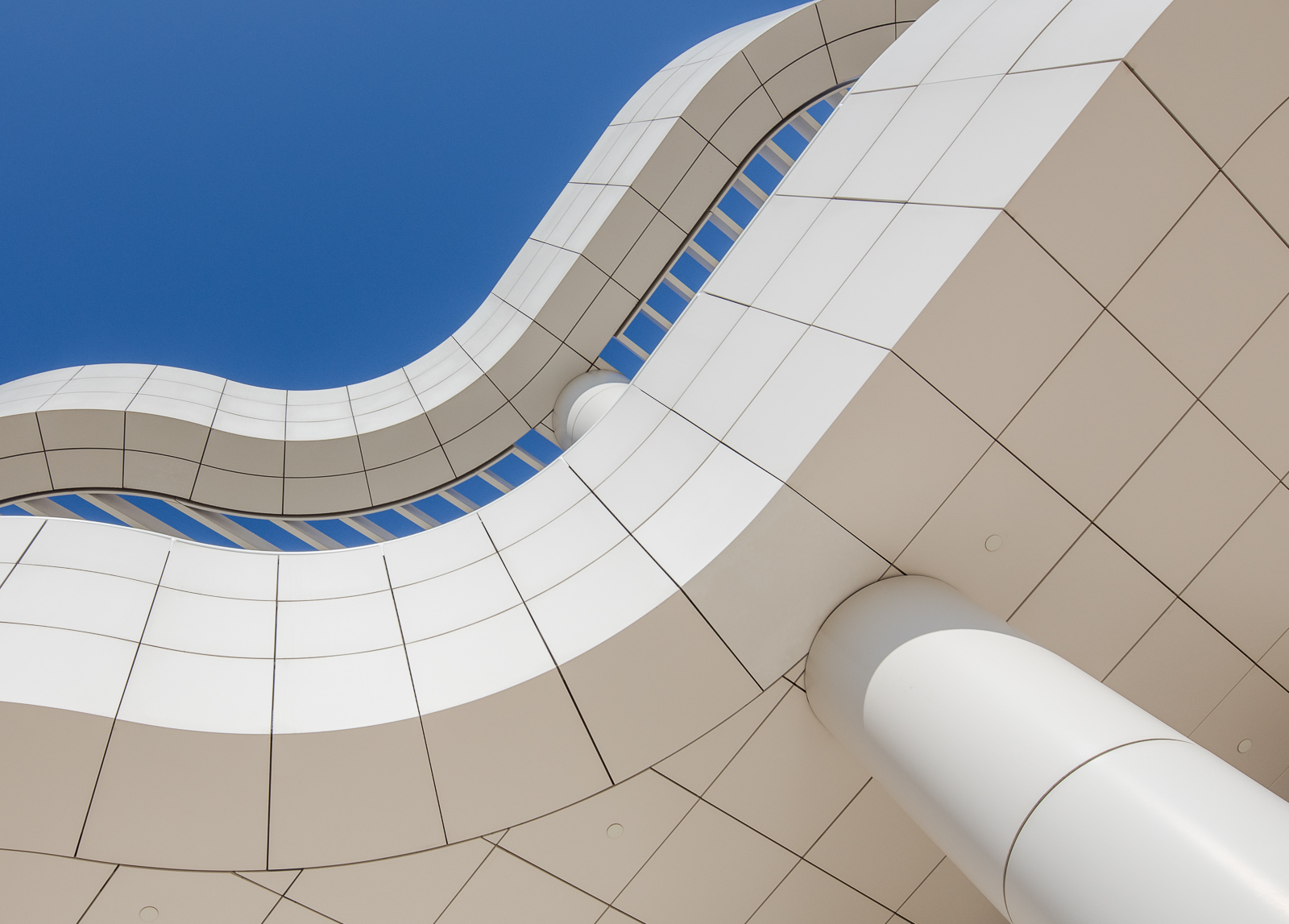 The Curved architecture of the J. Paul Getty Museum, eclipsing the sun in a cloudless skyGetty Museum