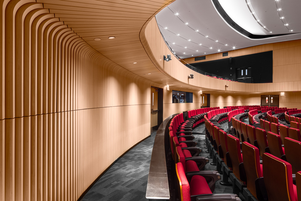 Beautiful wooden finishes at the Alumni Auditorium ceiling details at Columbia University Medical Center designed by MdeAS Architects