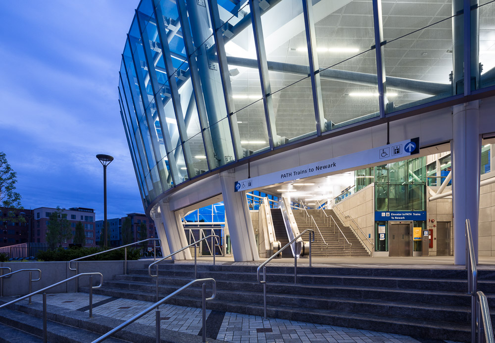 Detail shot of the PATH Harrison Station at dusk. Designed by Dattner Architects