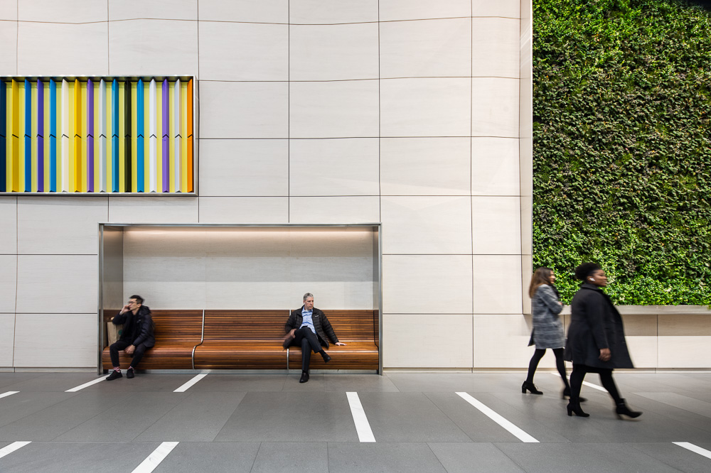 Renovated lobby bench by MdeAS Architects at Olympic Tower owned by Oxford Property Group