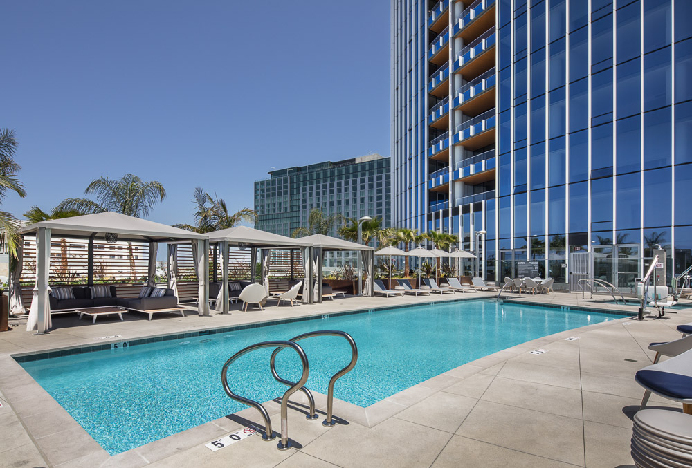 The pool terrace with poolside cabanas and an outdoor pet retreat area at the Pacific Gate