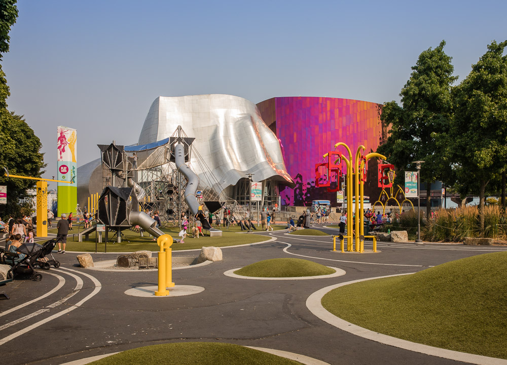 The playground and spectacular facade of the Museum of Pop Culture
