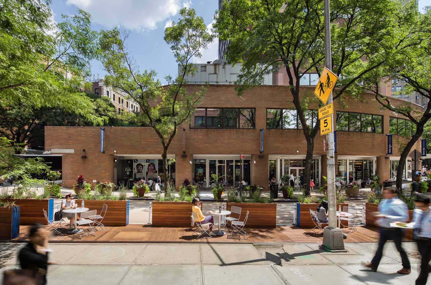 Street-level of seating area at Haven Plaza designed by FXCollaborative Architects