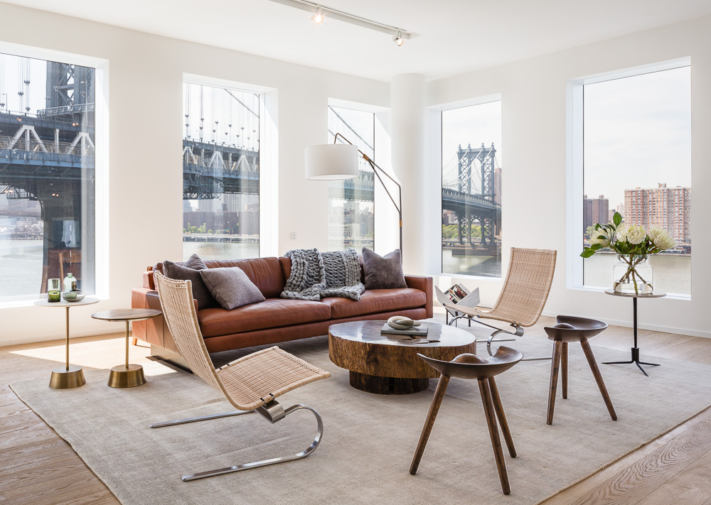 Living room area of a One John St apartment in DUMBO, by Alloy development