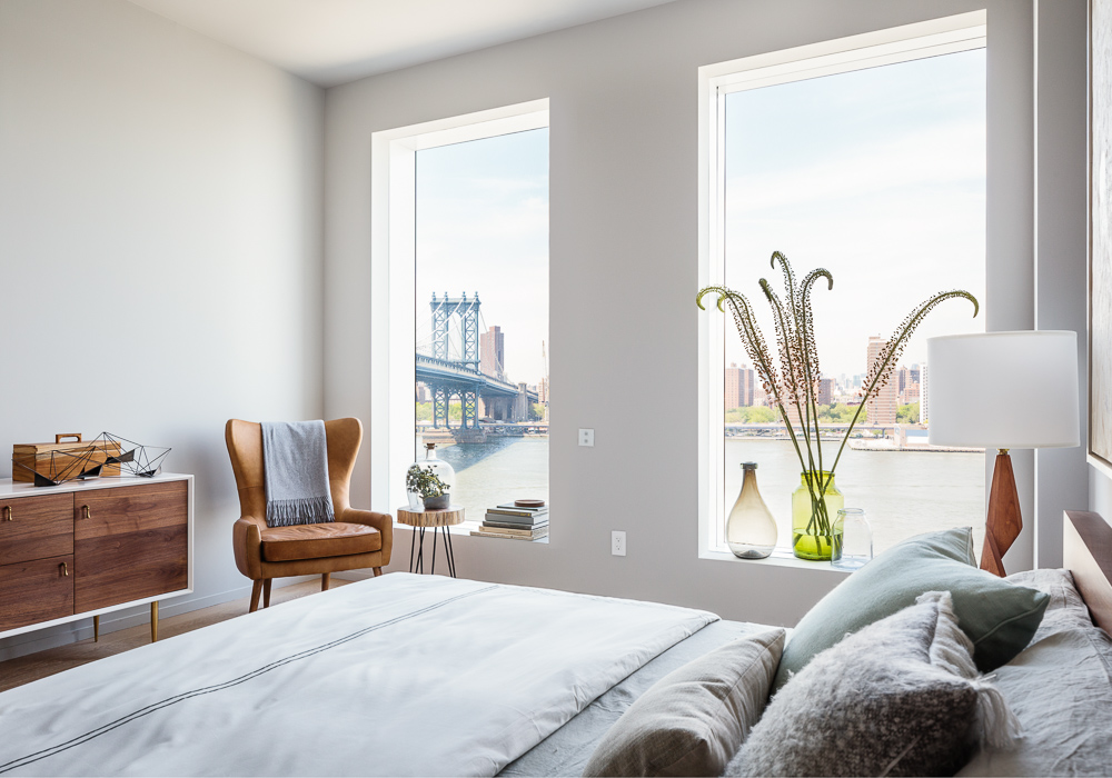 Master bedroom of a One John St apartment in DUMBO, by Alloy development