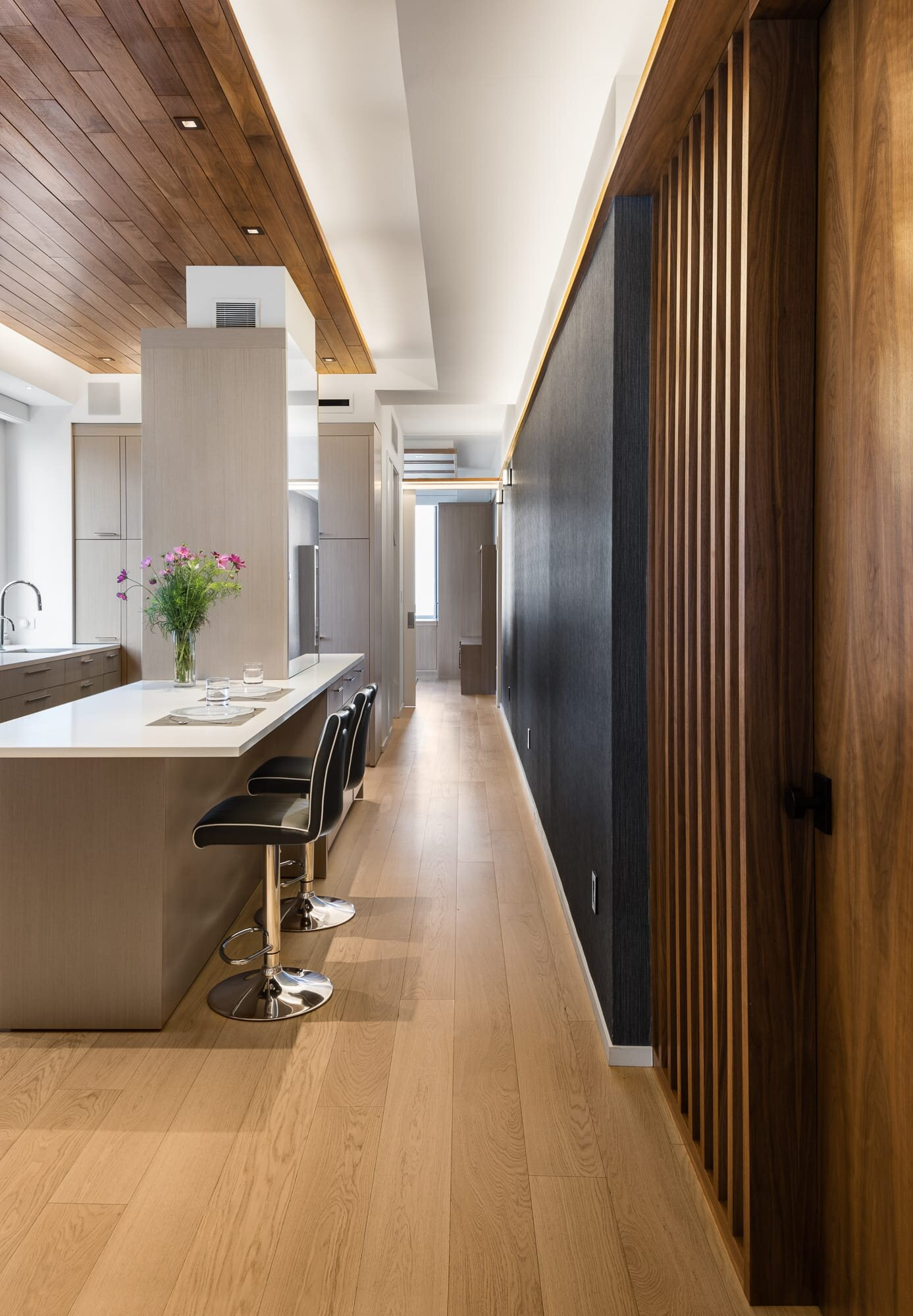 Luxury kitchen through the hallway to another room