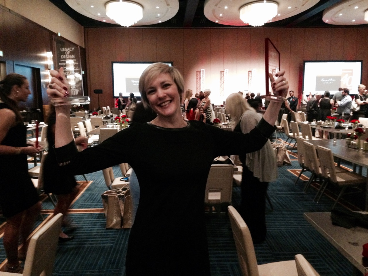 Robin Colton with her Legacy of Design first place trophies.