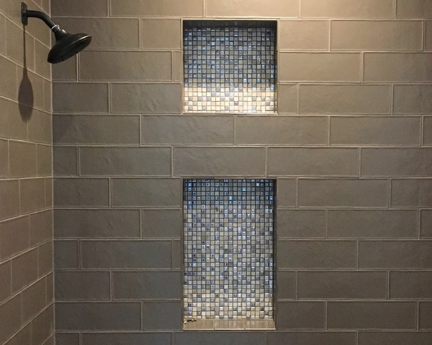 Niches for toiletries must be built into the shower during the framing stage.