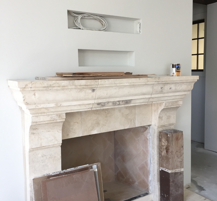 Wiring for a television is framed out above the fireplace early on.