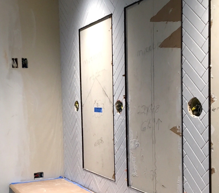 Wiring for wall sconces is correctly placed in the walls even before any tile is installed.