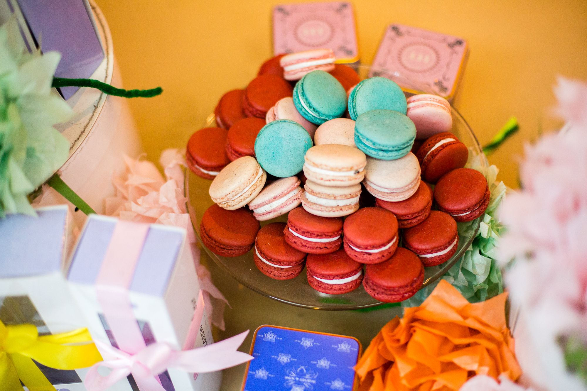"""I still have no idea what Macarons actually are, but we got some. She got a lemon basil for her and her friend. We brought Sarah back an """"Elvis"""" with bananas and peanut butter. For her brother: Cheetos flavored Macaron."""