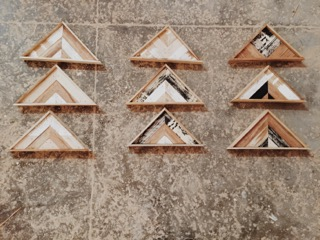 """tiny triangle"" #1-#3 (first row top to bottom) #4-#6 (second row top to bottom) #7-#9 ( third row top to bottom) 13.5 in. x 7 in. stain on redwood panel $95 each."