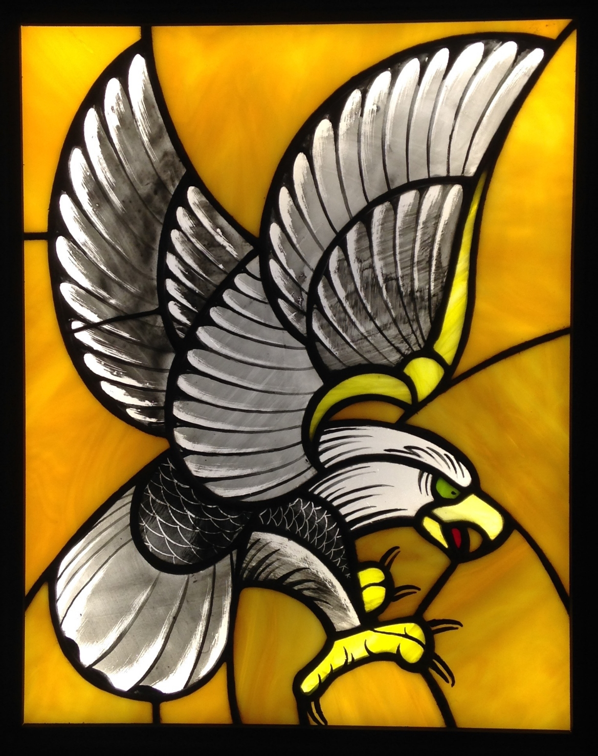 """SCREAMIN' EAGLE"" 11""X14""(SIZE OF JUST GLASS) Foiled stained glass, kiln fired glass paint, & LED lights  $1250"