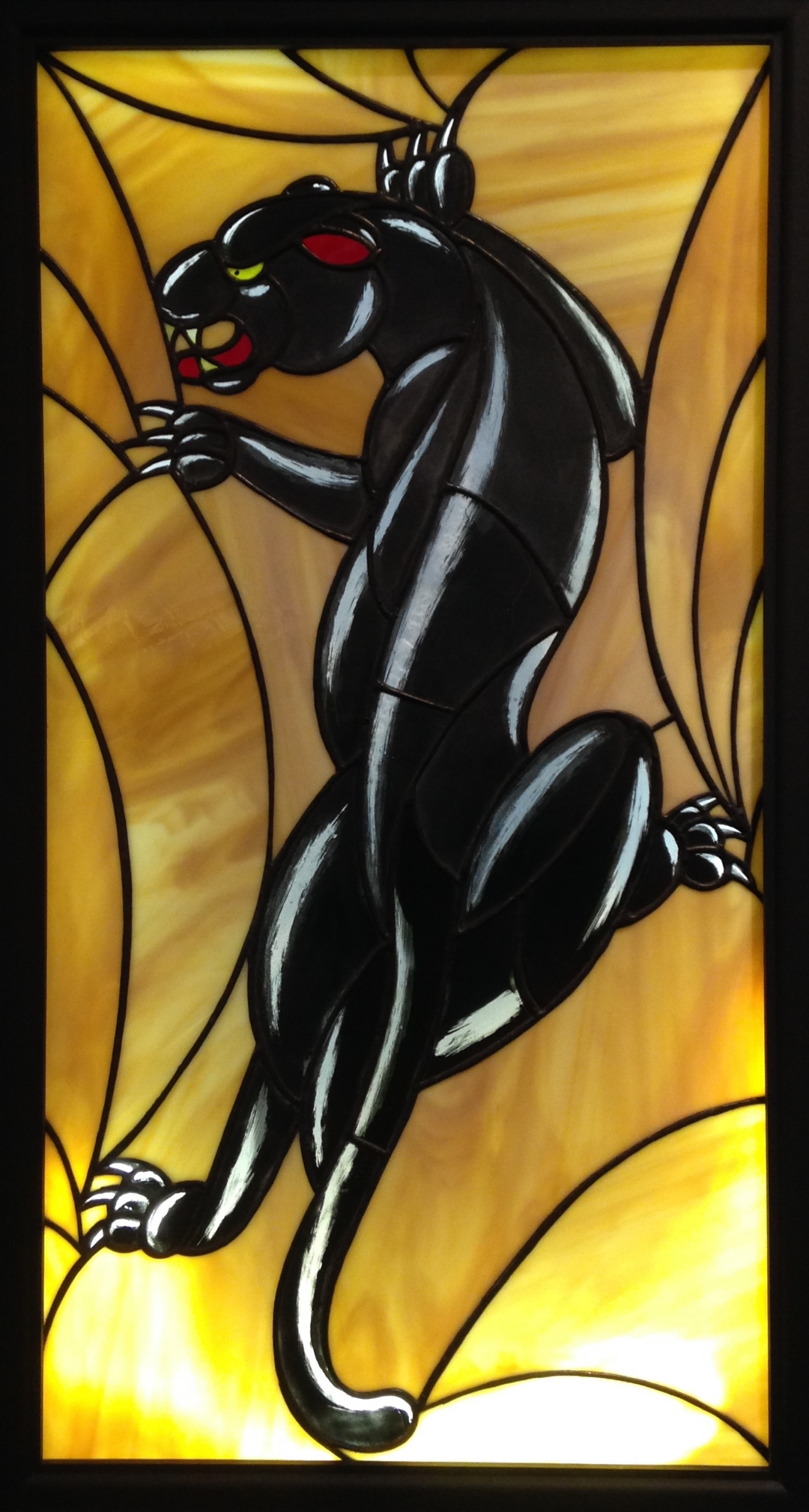 """PANTERA NEGRA"" 16""X31"" (SIZE OF GLASS ONLY) Foiled stained glass, kiln fired glass paint, & LED lights $2500"