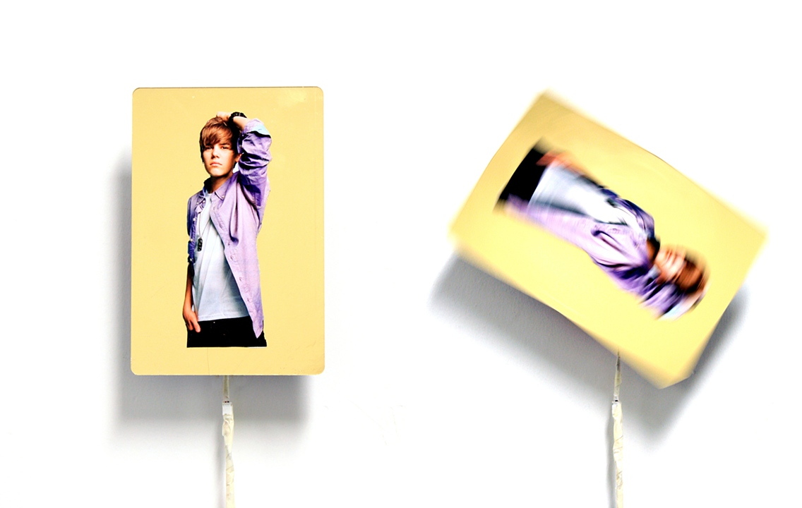 Bieber Fever   2011   Collaged print advertisement on gold acrylic sheet, electronics