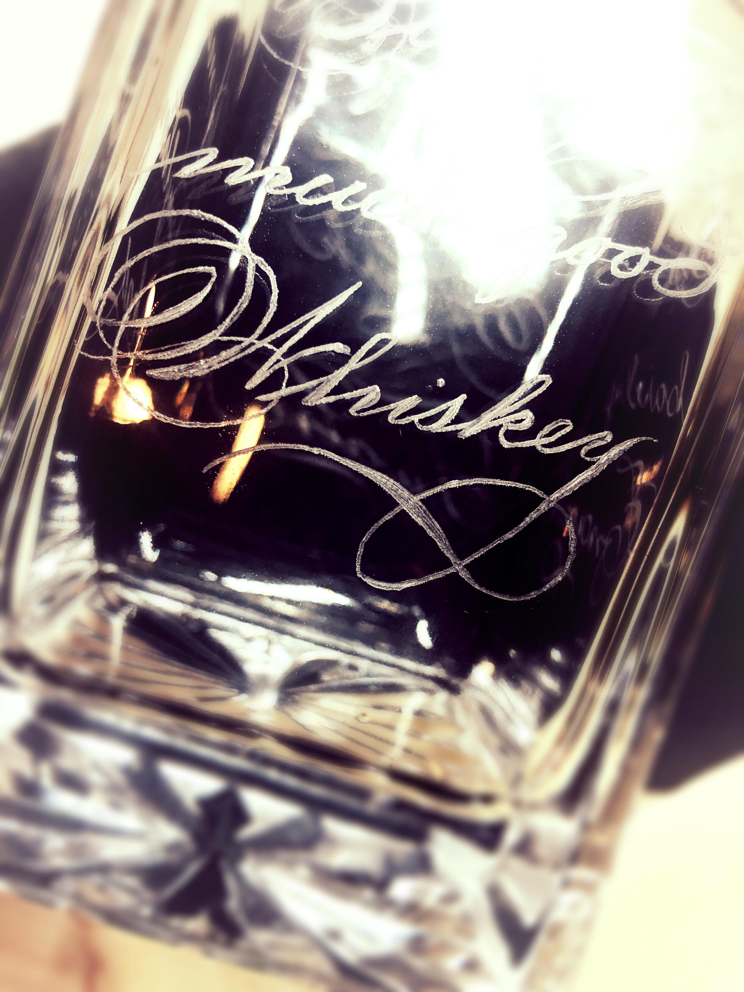 Houston wine bottle and whiskey decanter engraving