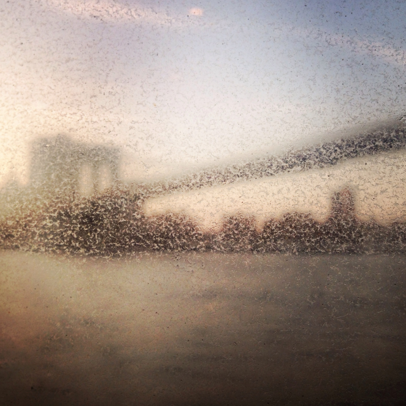 iPhone shot of the Brooklyn Bridge, taken through the window of the East River Ferry.