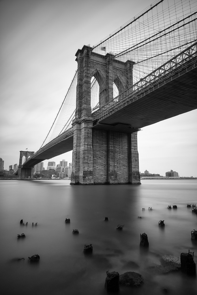 """Brooklyn Bridge"" May 2014, New York City Fujifilm XPro1, 14mm, f/8, 240 seconds, ISO 200   Here's another shot from the same evening. I love how foggy the water looks around the pylons. The scene feels totally silent except for the flapping of the flag on top of the bridge. (Of course, it was far from it, with horns blaring overhead on the FDR Expressway)"