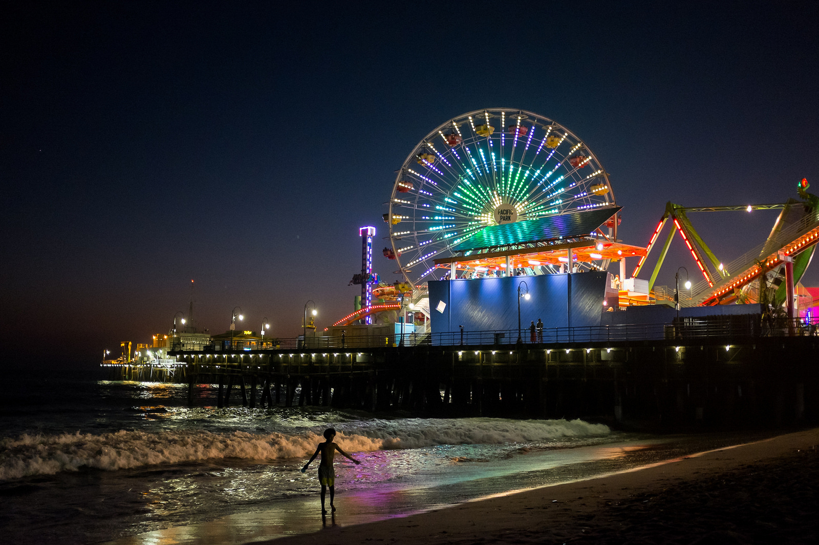 """The night swimmer""  August, 2016. Santa Monica, CA  Fujifilm X100s, 23mm, f/2, 1/70, ISO 6400"