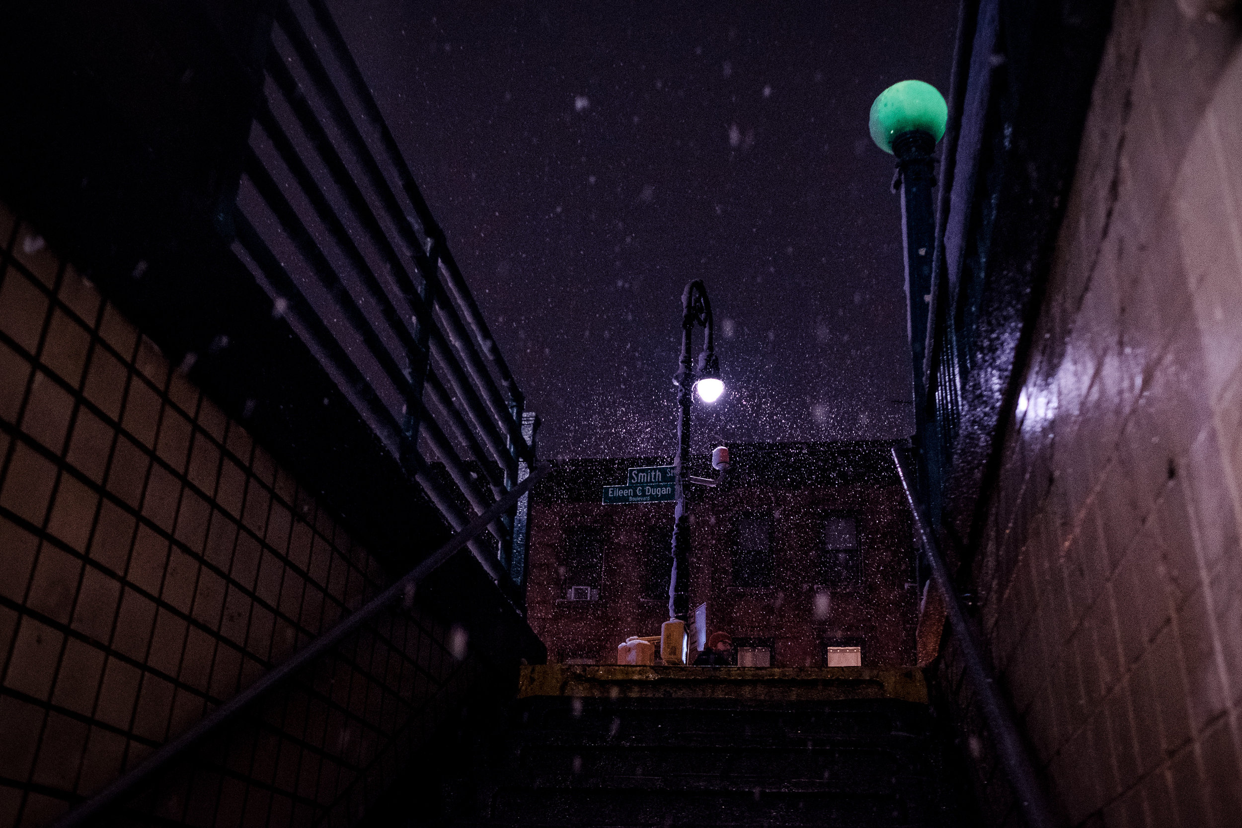 """Carroll Street Station"" Carroll Gardens, Brooklyn Fujifilm X Pro2, 23mm, f/2.8, 1/220 sec, ISO 6400    I see this view of the exit from the Carroll Street subway station just about every day. It's totally unremarkable. But add some giant fluffy snowflakes and suddenly it's a scene from a movie."