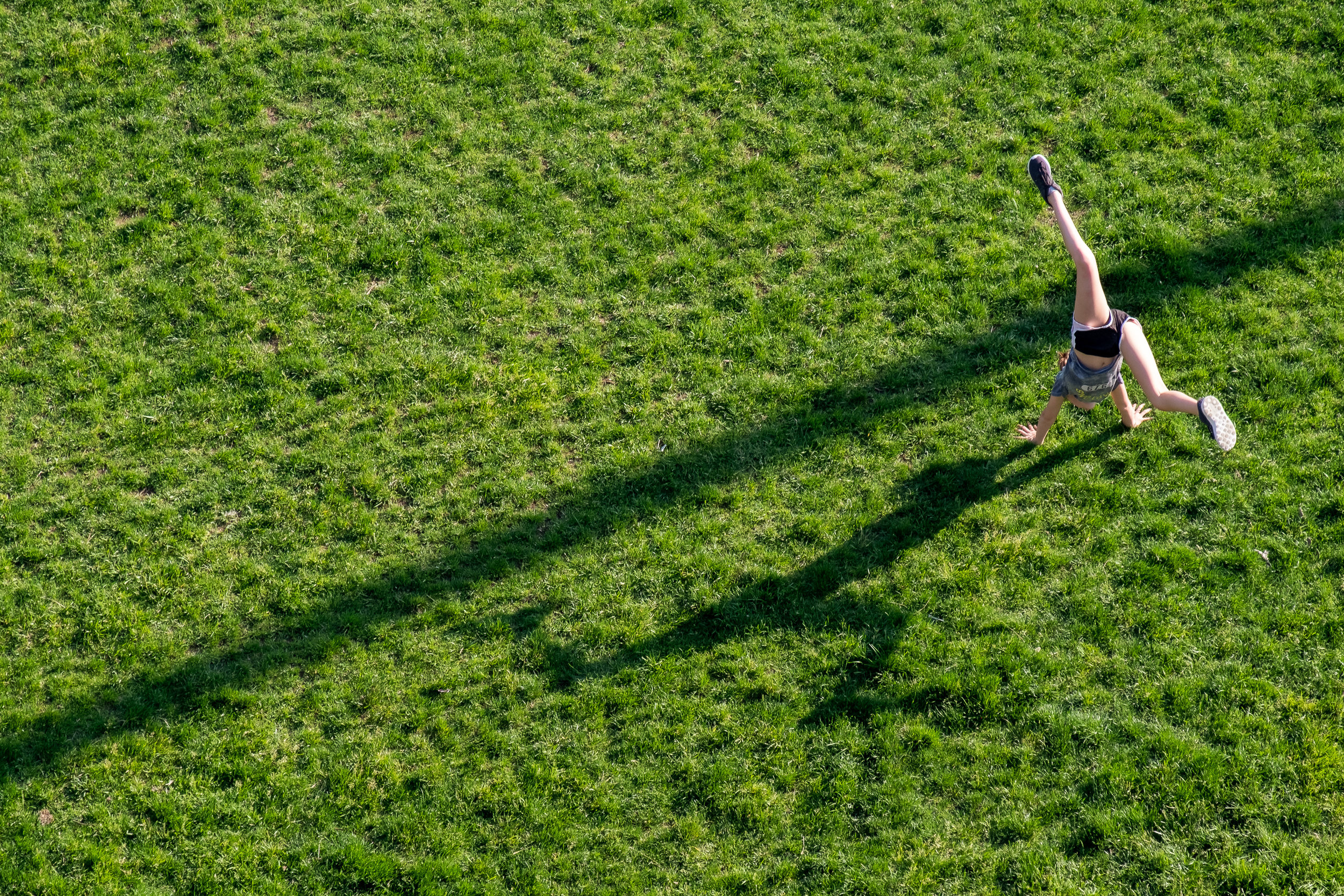 """Cartwheels and shadows"" May 25, 2018. DUMBO, Brooklyn Fujifilm XPro2, 55-200mm, f/8, 1/250 sec, ISO 320   Another shot from the Manhattan Bridge pedestrian walkway. This was looking down over Brooklyn Bridge Park in DUMBO."