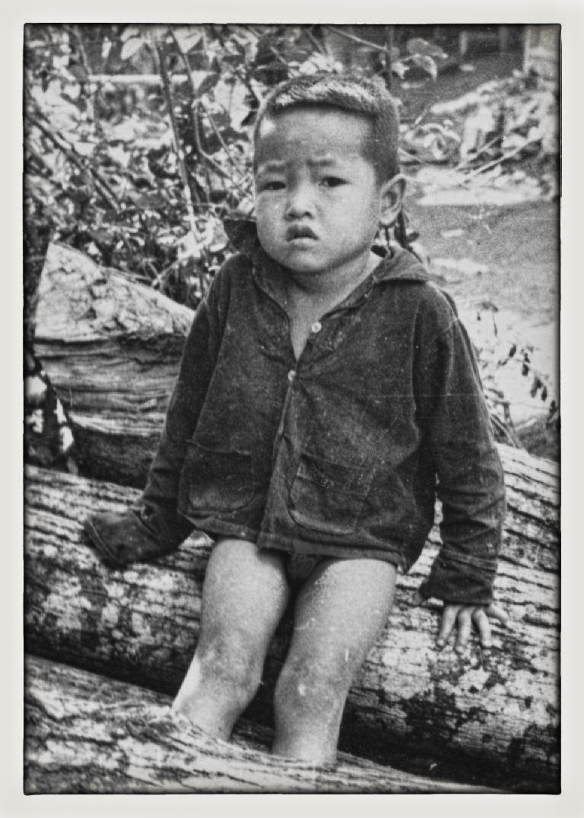 little boy on log.jpg