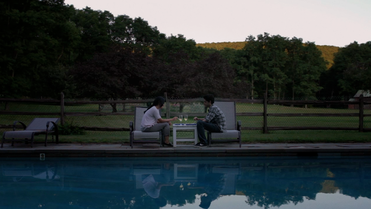 Alex and Alice by pool at dusk.png