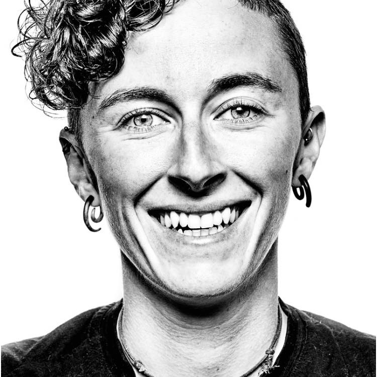 """Elyse Rylander - Elyse Rylander (she/her) is the founder of OUT There Adventures, a 501(c)3 dedicated to further bridging the gap between the LGBTQ community and the world. Along this path, Elyse has worked to reduce outdoor access barriers for the LGBTQ community. In 2018, Elyse was named a """"Top Woman in Conservation and Environmental Justice"""" by ECODiversity Magazine. Outside of her work, Elyse is known for her sense of humor best conveyed through perfectly timed message GIFs, and in her (rare) free time she can be found paddling through the central Salish Sea."""