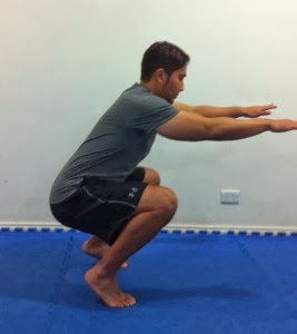 If your heels come up off the floor as you squat, you may be leaning too far forward or squatting too narrow.