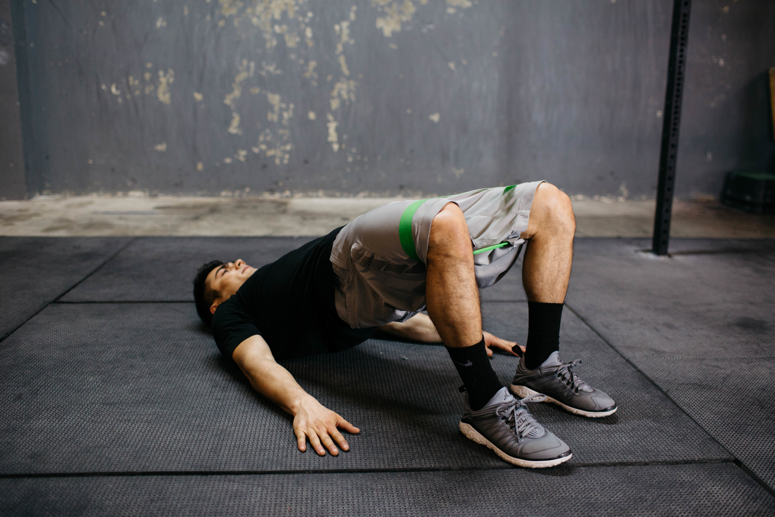 """""""Prehab"""" exercises like the Band Hip Bridge help correct quad-dominant cycling and prevent injuries."""