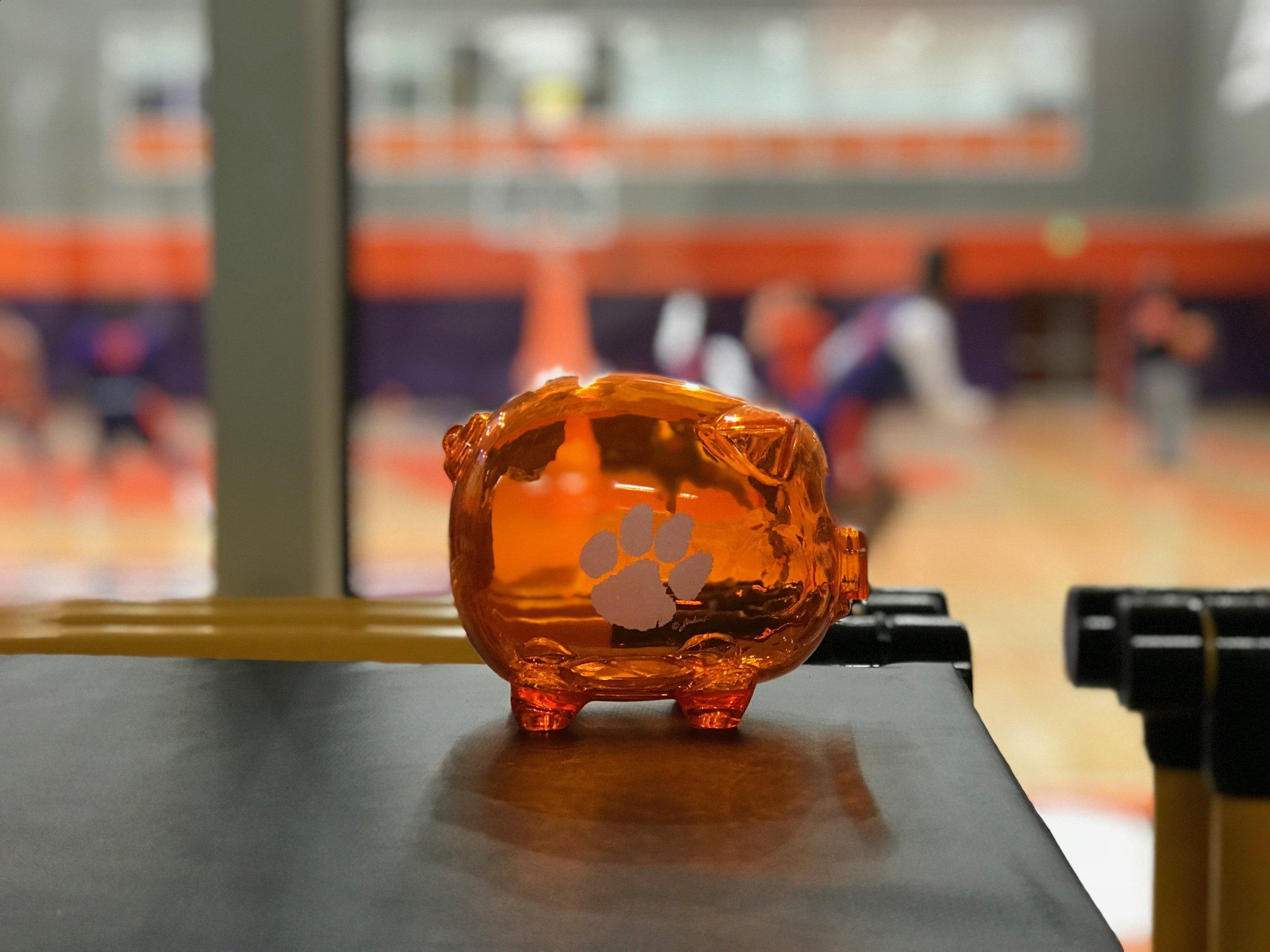 """Coach Cunningham's """"Make an Investment"""" piggy bank."""