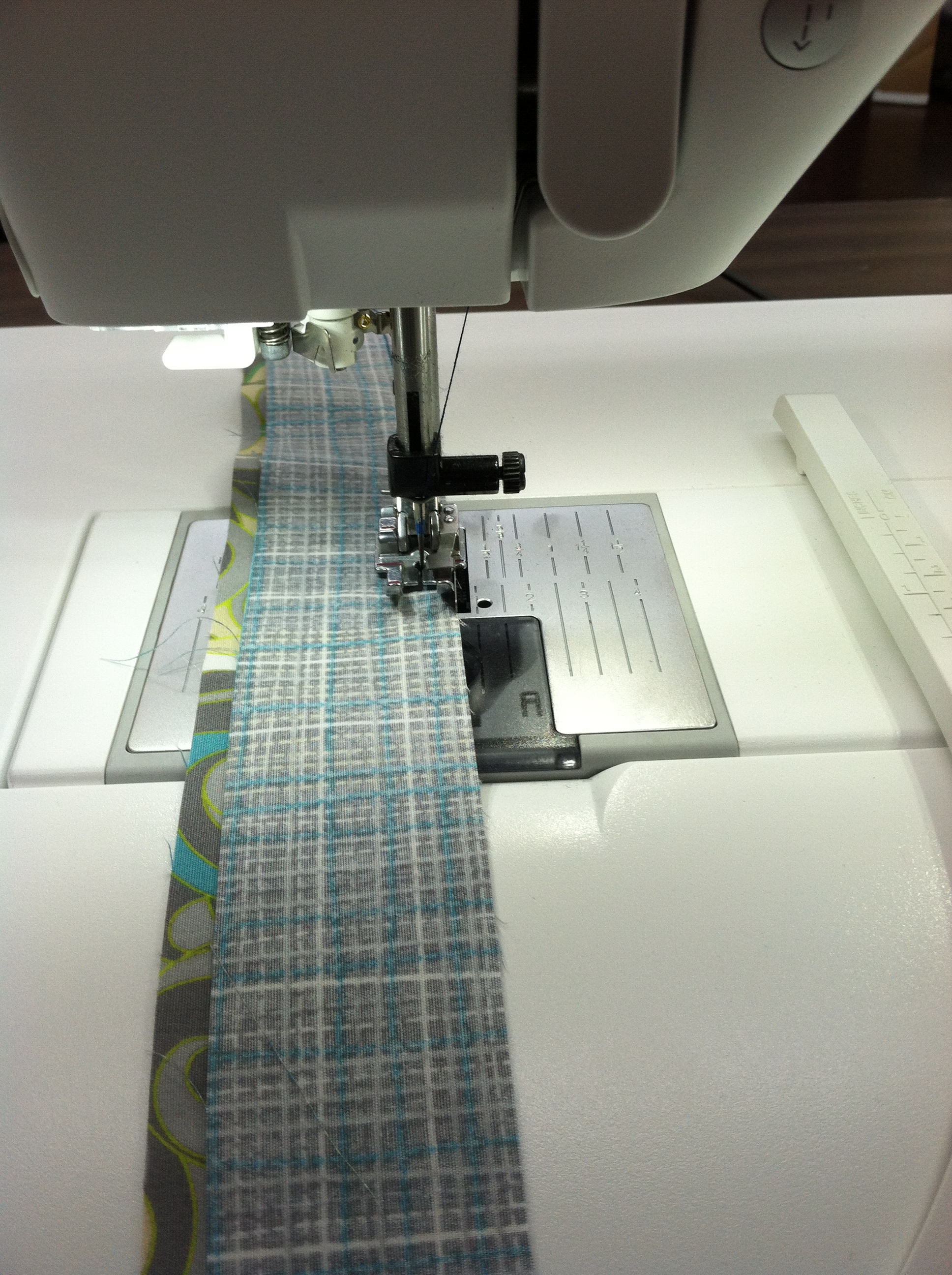 Sewing my two binding pieces together.