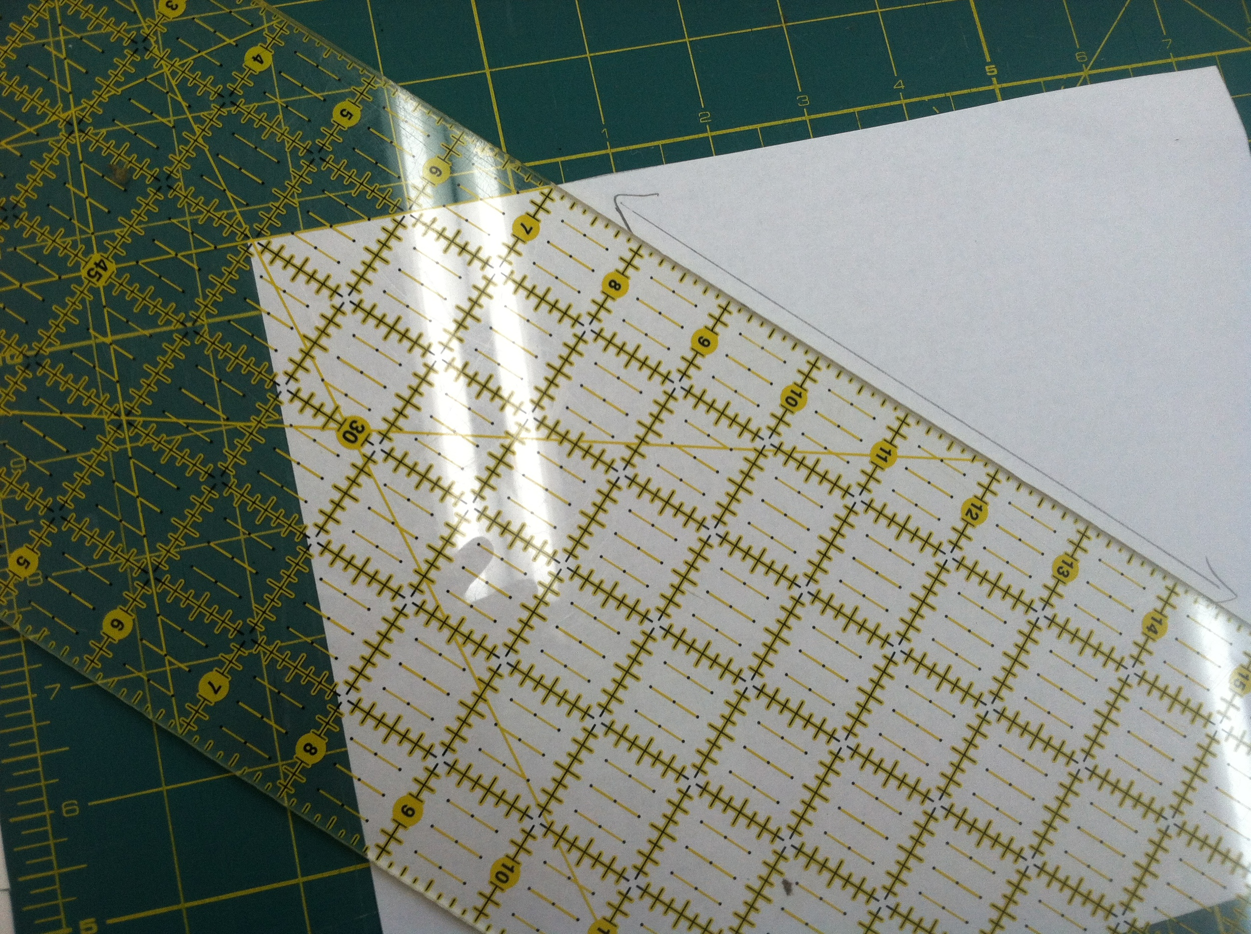 You can see I used the 45 degree line on my ruler to mark an arrow on my new pattern piece.