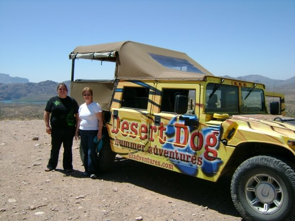 Linda and I posing for a photo next to the awesome Hummer that took us through the desert in Arizona. That was a great time!