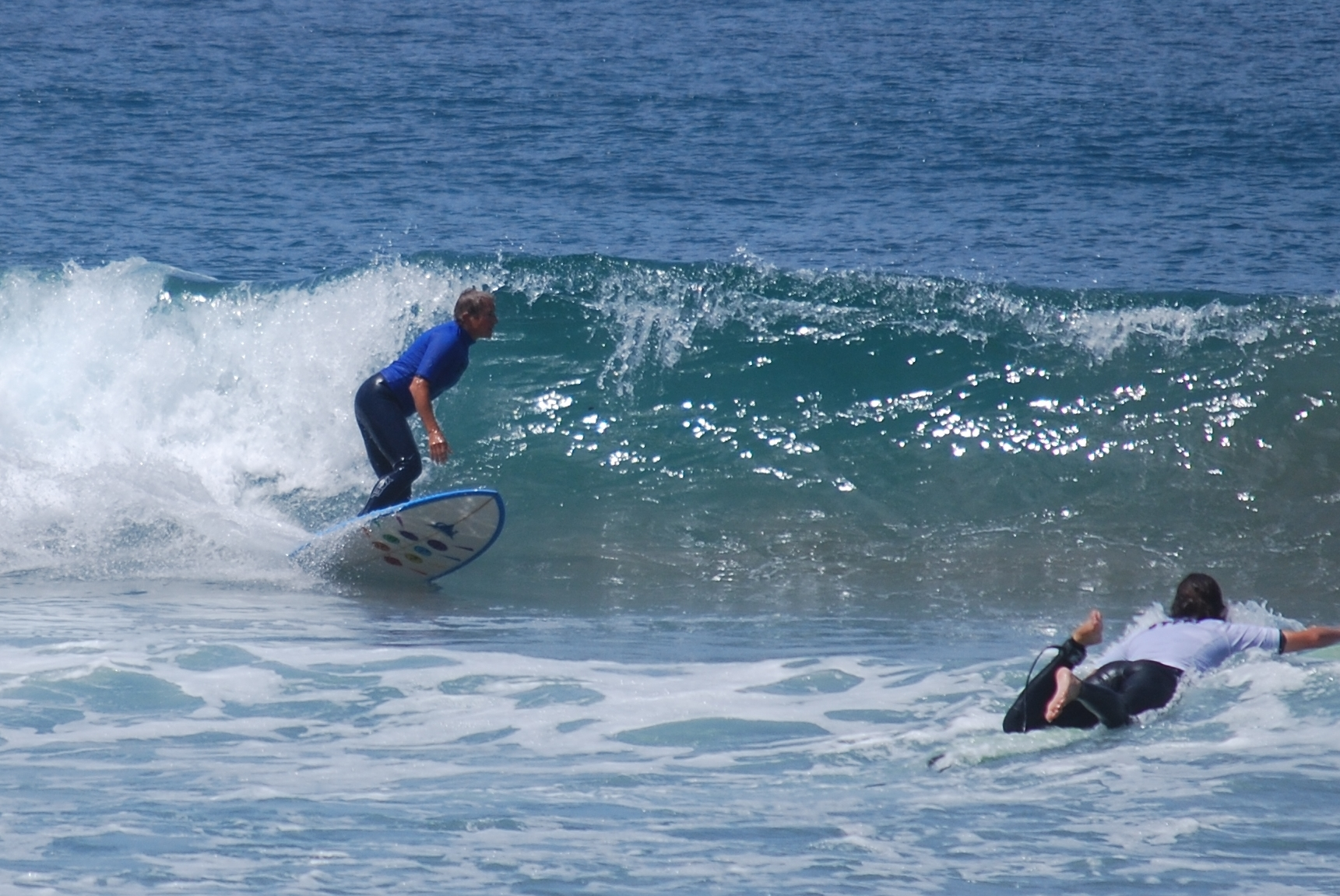 Lori Malkoff, MD surfing in the annual Stone Steps contest finals 2013