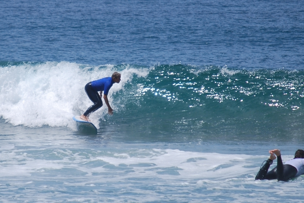 Lori Malkoff, MD surfing in the annual Stone Steps contest 2013