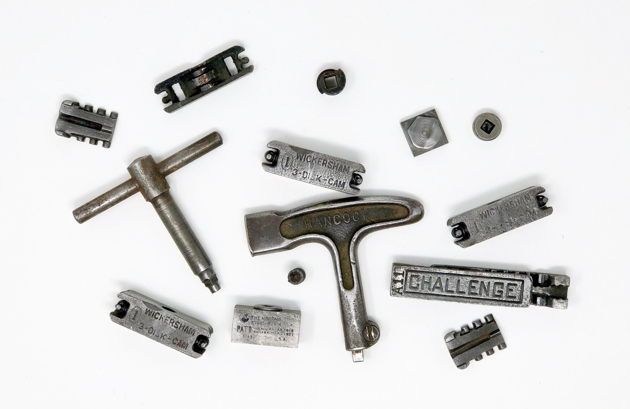 A variety of quoins, some of them disassembled, and two quoin keys.