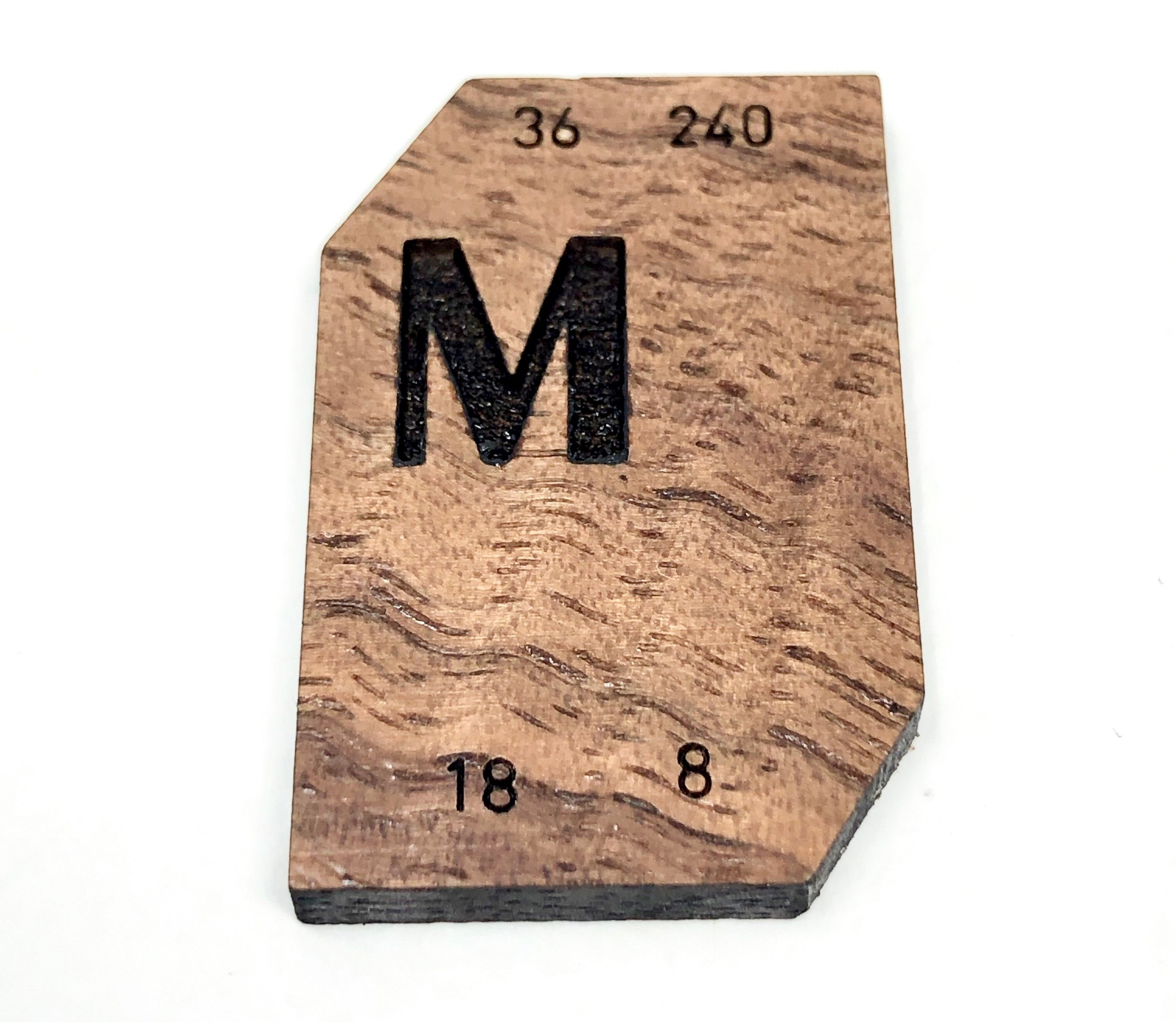 A wood laser-engraved version of a Monotype Electro Display Matrix