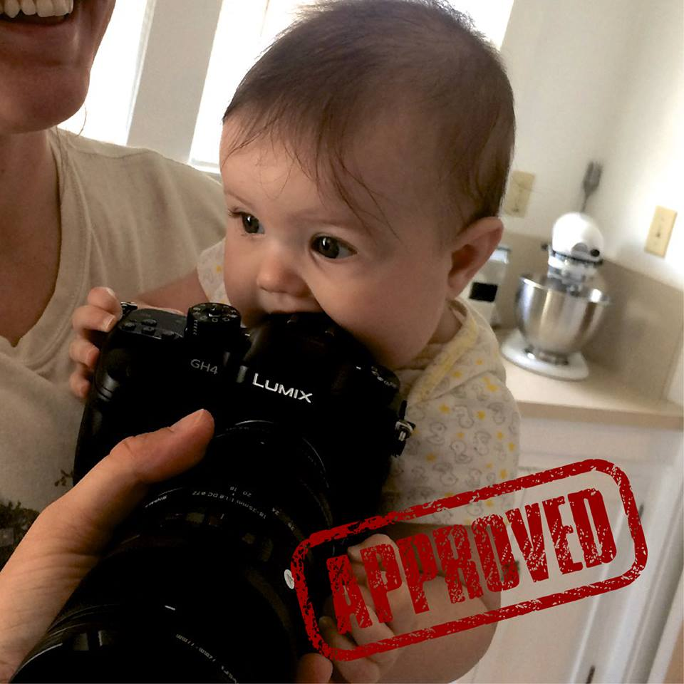 Unboxing the new GH4 camera with baby Avi - who promptly started chomping on it.