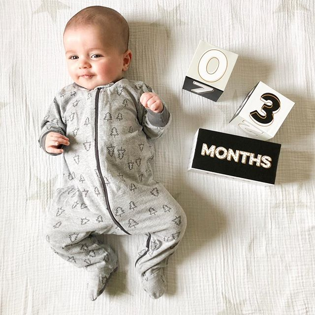 3 months old (9 days ago)! You have brought so much happiness into our little world, sweet boy. You're waking once at night, and LOVE a good swing nap. You're ooohing and ahhing at us all the time, and you're happy as a clam as long as you're well rested. Your hands are your most recent fascination and Ruby is responsible for your biggest smiles. What was life like without you?